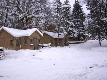 cabins in winter in the manistee forest